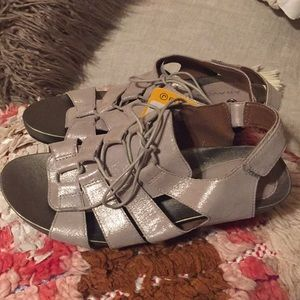 Brand new with tags silver sandal.